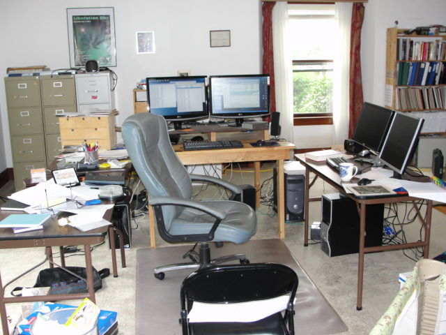 My cluttered office, with chair confined to mat.